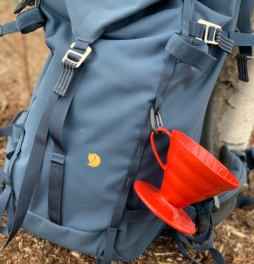 backpack with pour over coffee maker attached