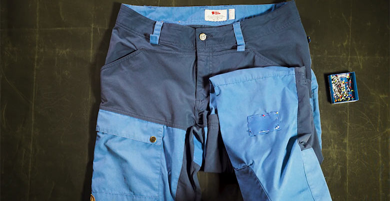 image of blue touring trousers with a patch